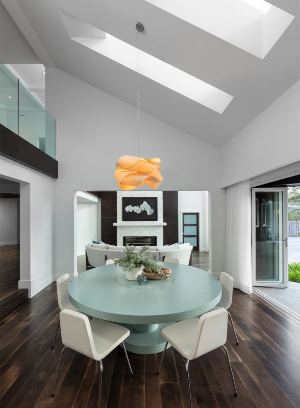 Interior Design Photograph captured in Kelowna of a Table in a dining room looking back to the living room