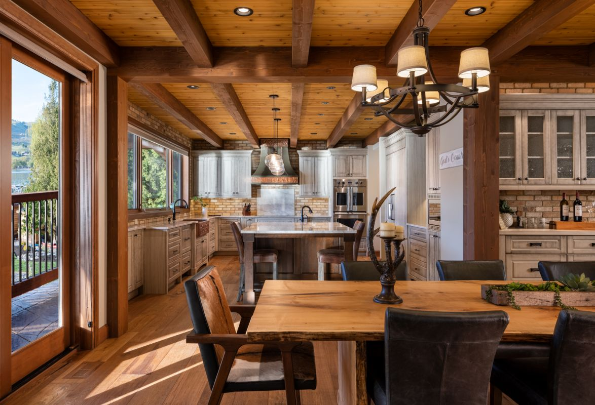 Interior architectural photograph by Shawn Talbot of kitchen and dining room in Keith Construction and European Timberframe luxury home in Vernon BC